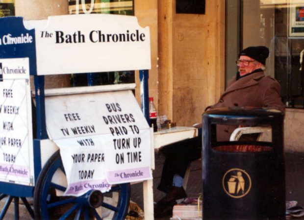 A newspaper vendor in Bath, UK