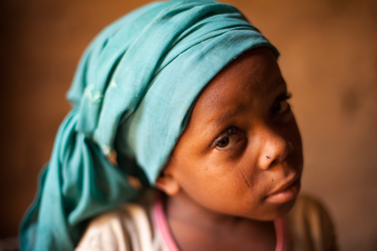Latifa, 8, poses for a photograph at her home in Saran Maradi, Niger.